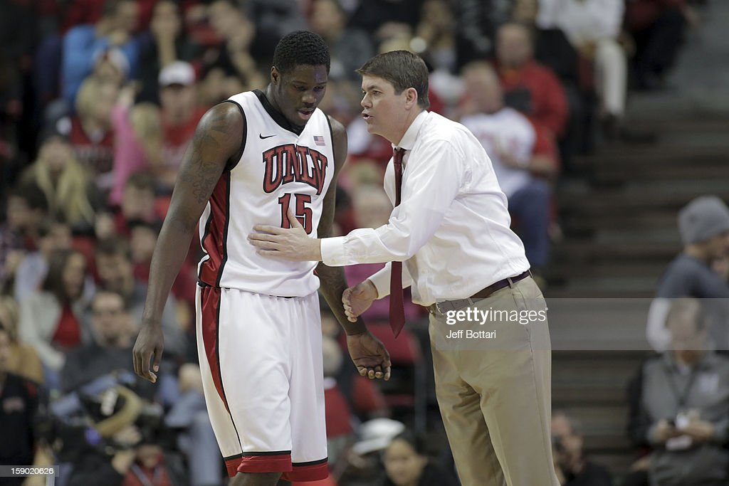 Head coach Dave Rice speaks with Anthony Bennett #15 of the UNLV Rebels near the bench during the game against the CSU Bakersfield Roadrunners at the Thomas & Mack Center on January 5, 2013 in Las Vegas, Nevada. UNLV won 84-63.