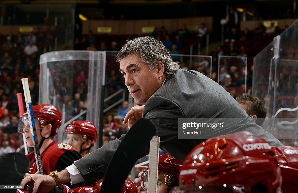Head coach Dave Tippett looks on from the bench during third period action against the Vancouver Canucks at Gila River Arena on February 10 2016 in...