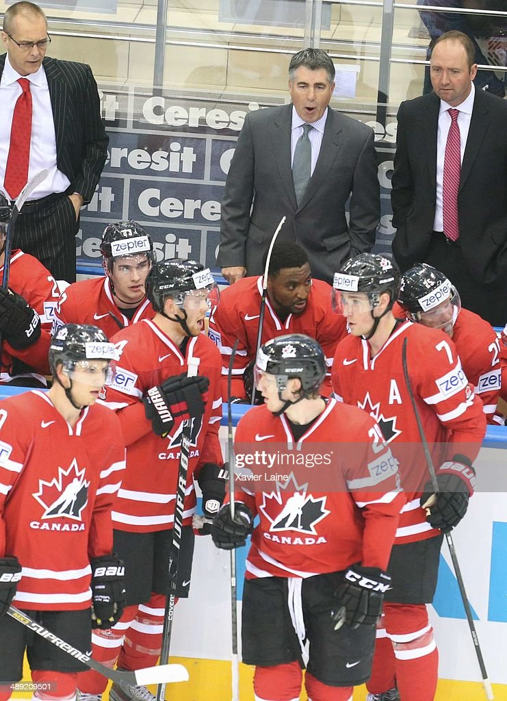 Head coach Dave Tippett of Canada speaks to his team during the 2014 IIHF World Championship between Canada and Slovakia at Chizhovka arena on May 10...