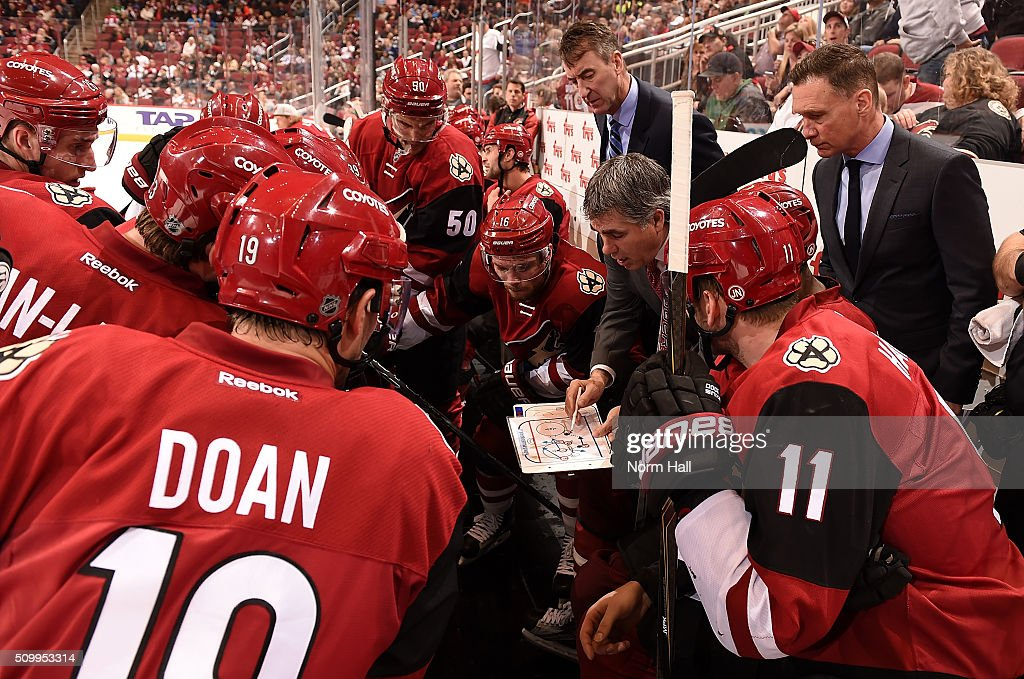 Head coach Dave Tippett of the Arizona Coyotes draws up a play for his team during a time out in the third period against the Vancouver Canucks at...