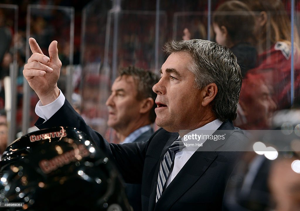 Head coach Dave Tippett of the Arizona Coyotes gestures toward the ice during third period action against the Calgary Flames at Gila River Arena on...