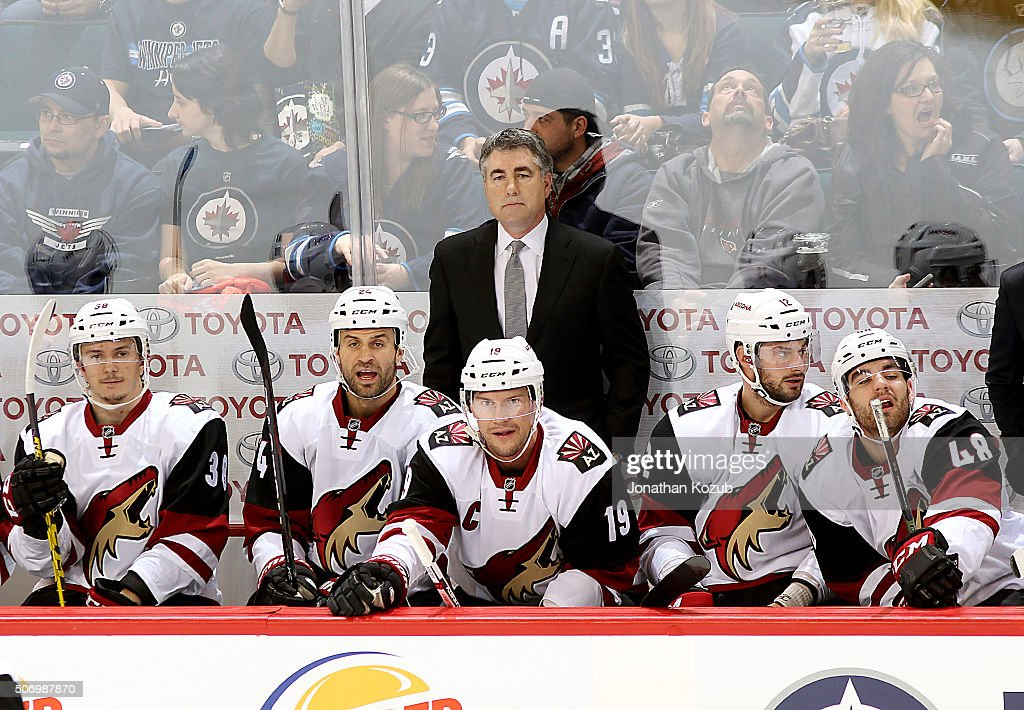 Head Coach Dave Tippett of the Arizona Coyotes looks on during first period action against the Winnipeg Jets at the MTS Centre on January 26 2016 in...