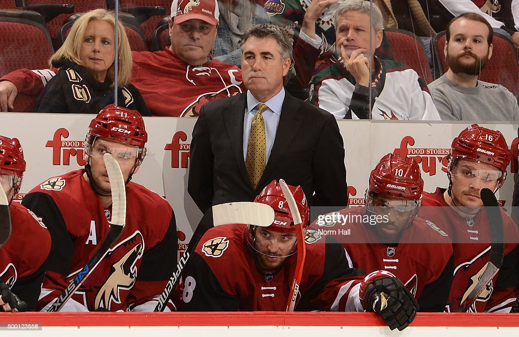 Head coach Dave Tippett of the Arizona Coyotes looks on from the bench during a game against the Ottawa Senators at Gila River Arena on November 28...