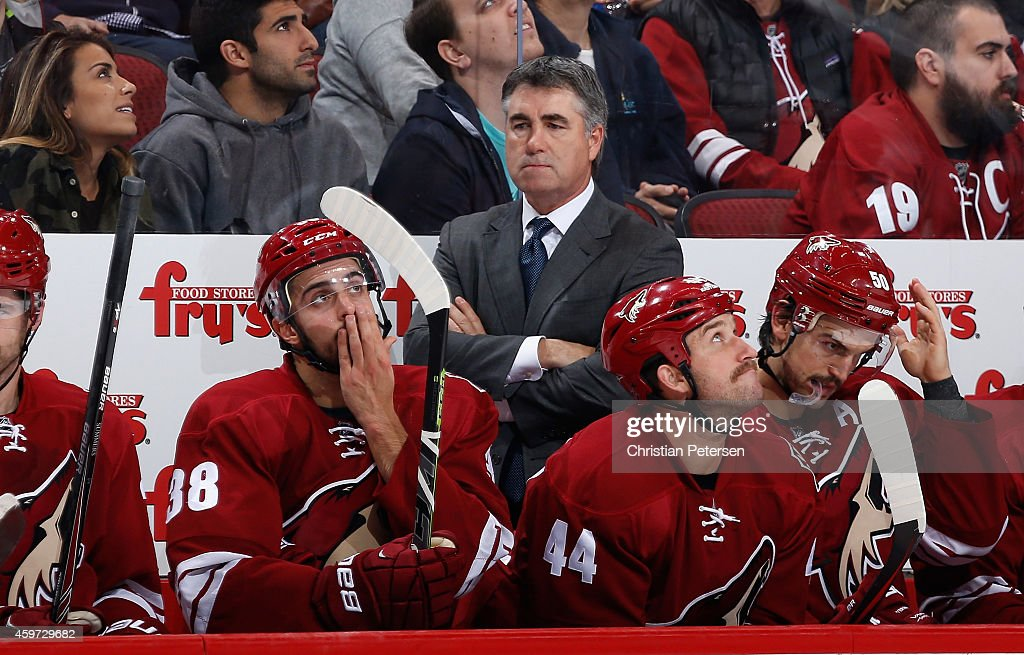Head coach Dave Tippett of the Arizona Coyotes looks on from the bench during the NHL game against the Washington Capitals at Gila River Arena on...