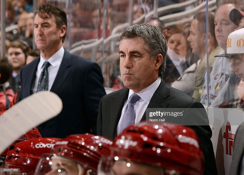 Head coach Dave Tippett of the Arizona Coyotes looks on from the bench during third period action against the New York Islanders at Gila River Arena...