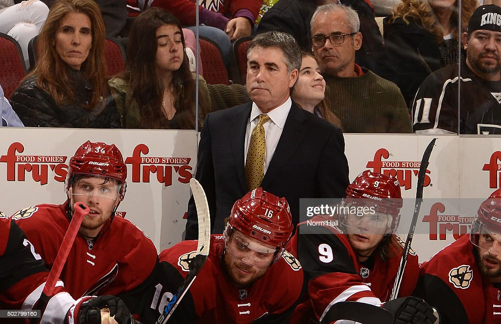 Head coach Dave Tippett of the Arizona Coyotes looks on from the bench against the Los Angeles Kings at Gila River Arena on December 26 2015 in...