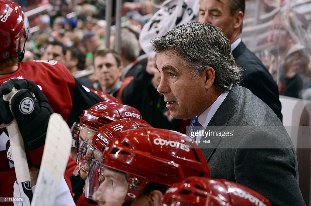 Head coach Dave Tippett of the Arizona Coyotes looks on from the bench during third period action against the Dallas Stars at Gila River Arena on...