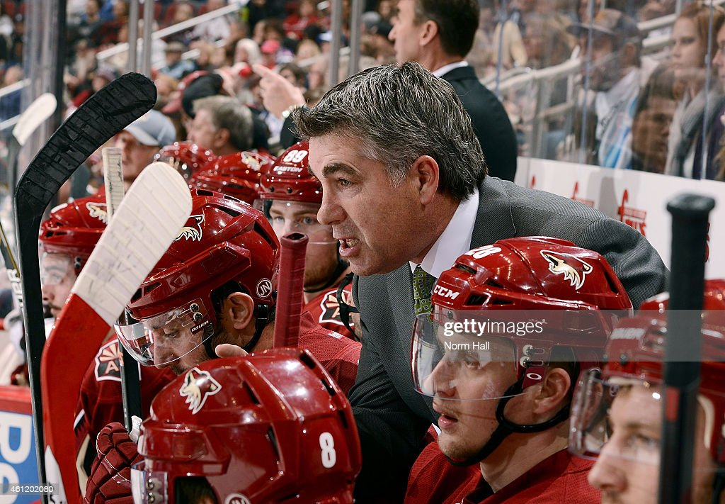 Head coach Dave Tippett of the Arizona Coyotes talks with players on the bench during first period action against the Winnipeg Jets at Gila River...