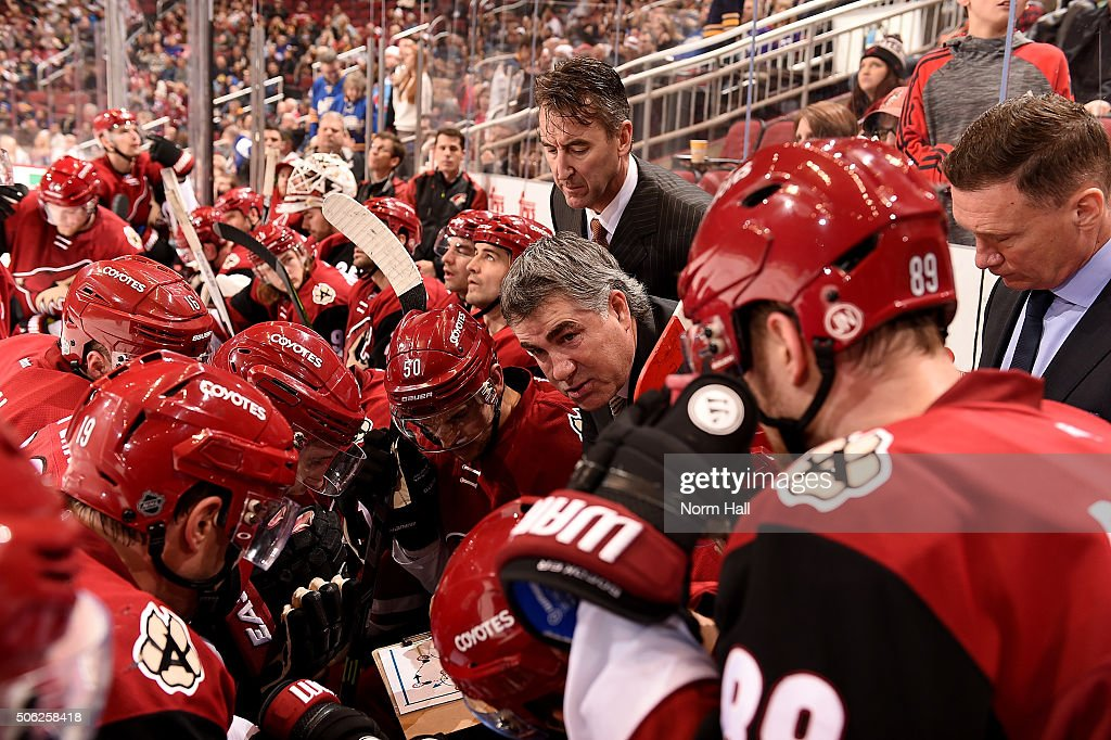 Head coach Dave Tippett of the Arizona Coyotes talks with players on the bench during a game against the Buffalo Sabres at Gila River Arena on...