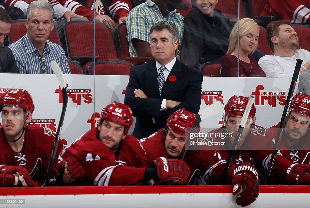 Head coach Dave Tippett of the Arizona Coyotes watches from the bench during the NHL game against the Dallas Stars at Gila River Arena on November 11...