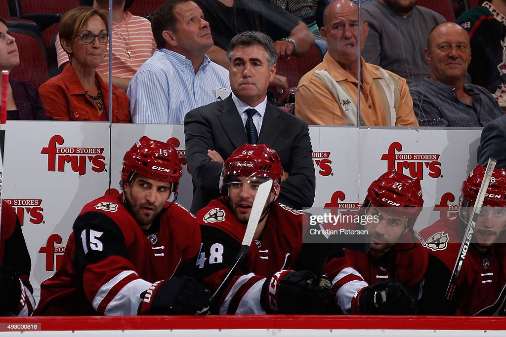 Head coach Dave Tippett of the Arizona Coyotes watches from the bench during the NHL game against the Minnesota Wild at Gila River Arena on October...
