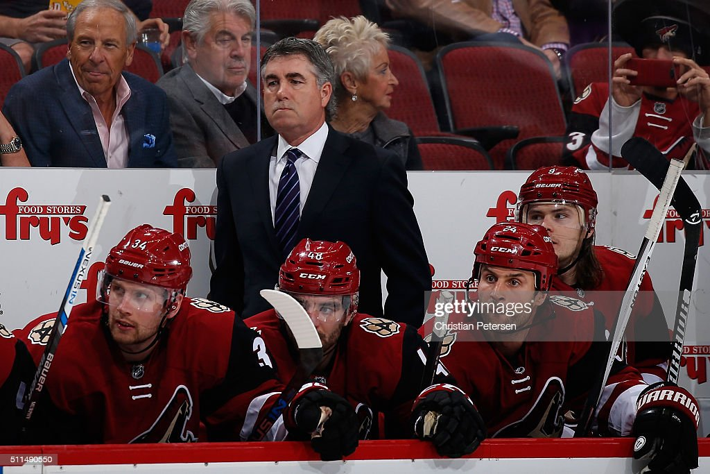 Head coach Dave Tippett of the Arizona Coyotes watches from the bench during the NHL game against the Dallas Stars at Gila River Arena on February 18...