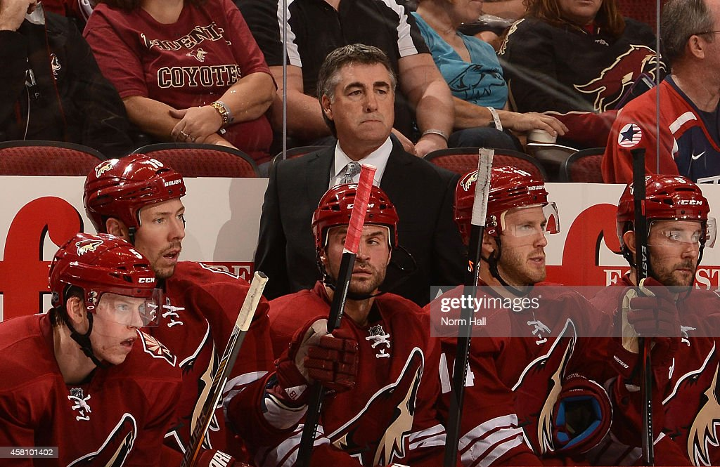 Head coach Dave Tippett of the Arizona Coyotes watches play from the bench against the St Louis Blues at Gila River Arena on October 18 2014 in...