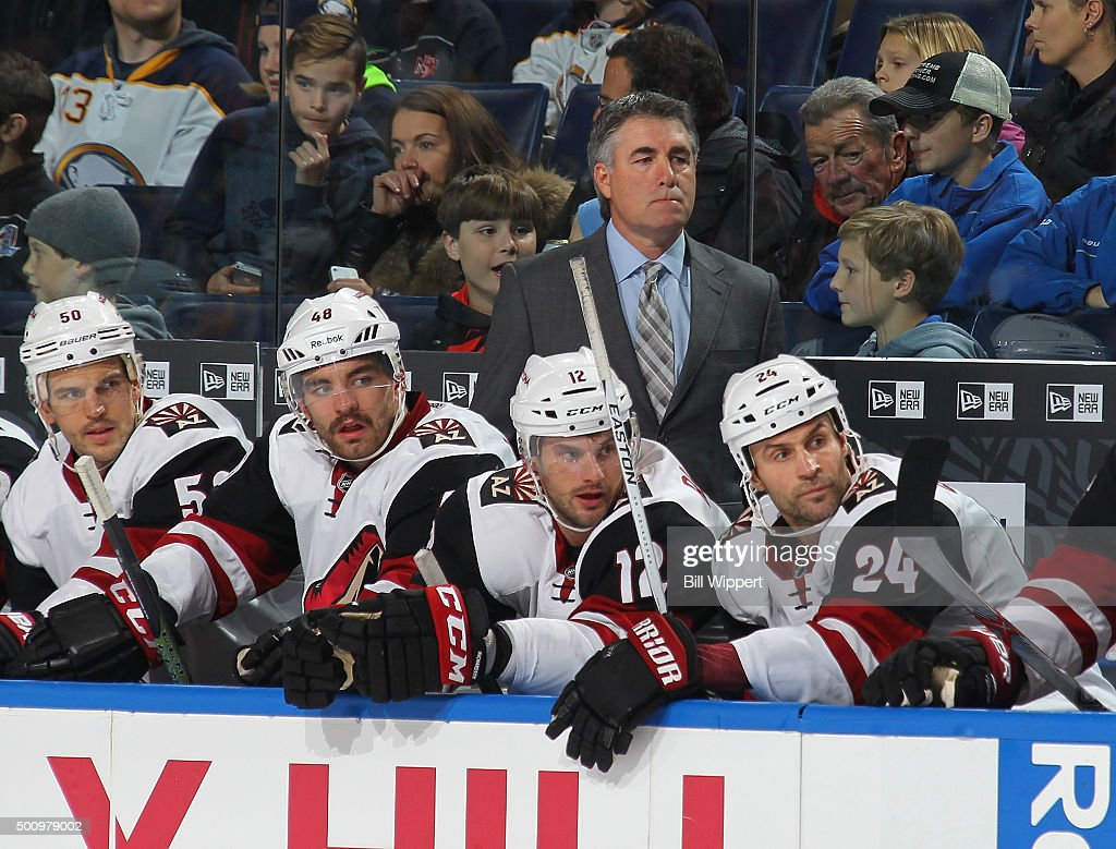 Head coach Dave Tippett of the Arizona Coyotes watches the action during an NHL game against the Buffalo Sabres on December 4 2015 at the First...
