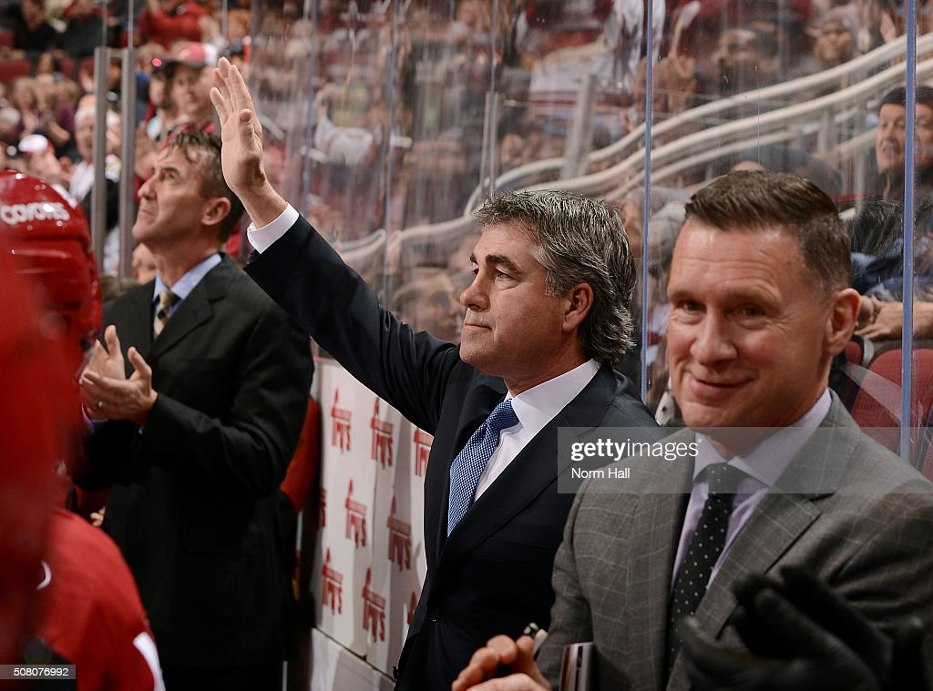 Head coach Dave Tippett of the Arizona Coyotes waves to the crowd as they acknowledge his 1000th game as a head coach during a game against the Los...