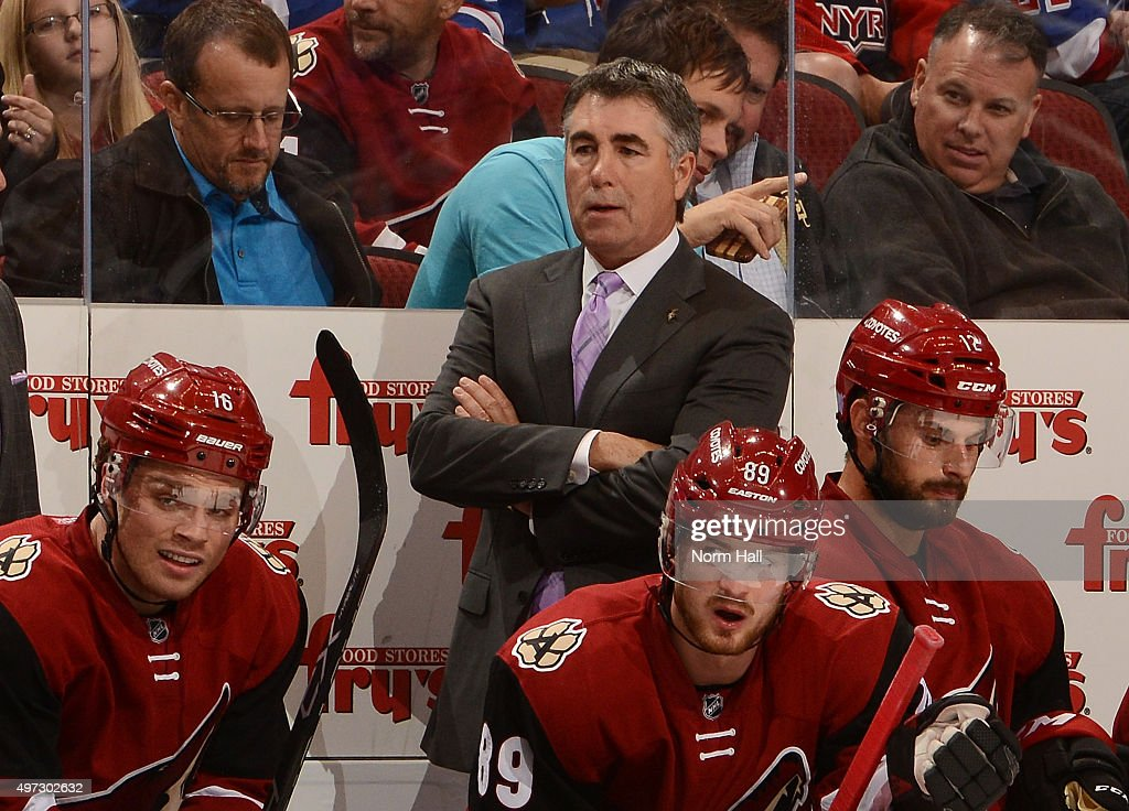 Head coach Dave Tippett of the Arizona Coyotes wears a Hockey Fights Cancer tie during a stoppage in play against the New York Rangers at Gila River...