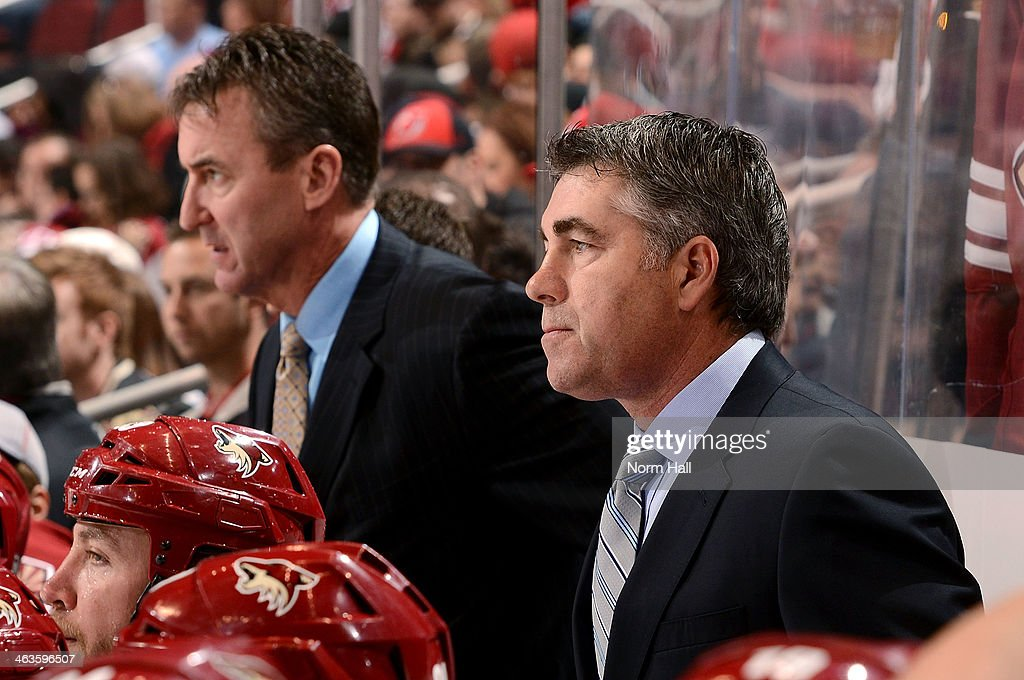Head coach Dave Tippett of the Phoenix Coyotes looks on from the bench during a game against the New Jersey Devils at Jobingcom Arena on January 18...