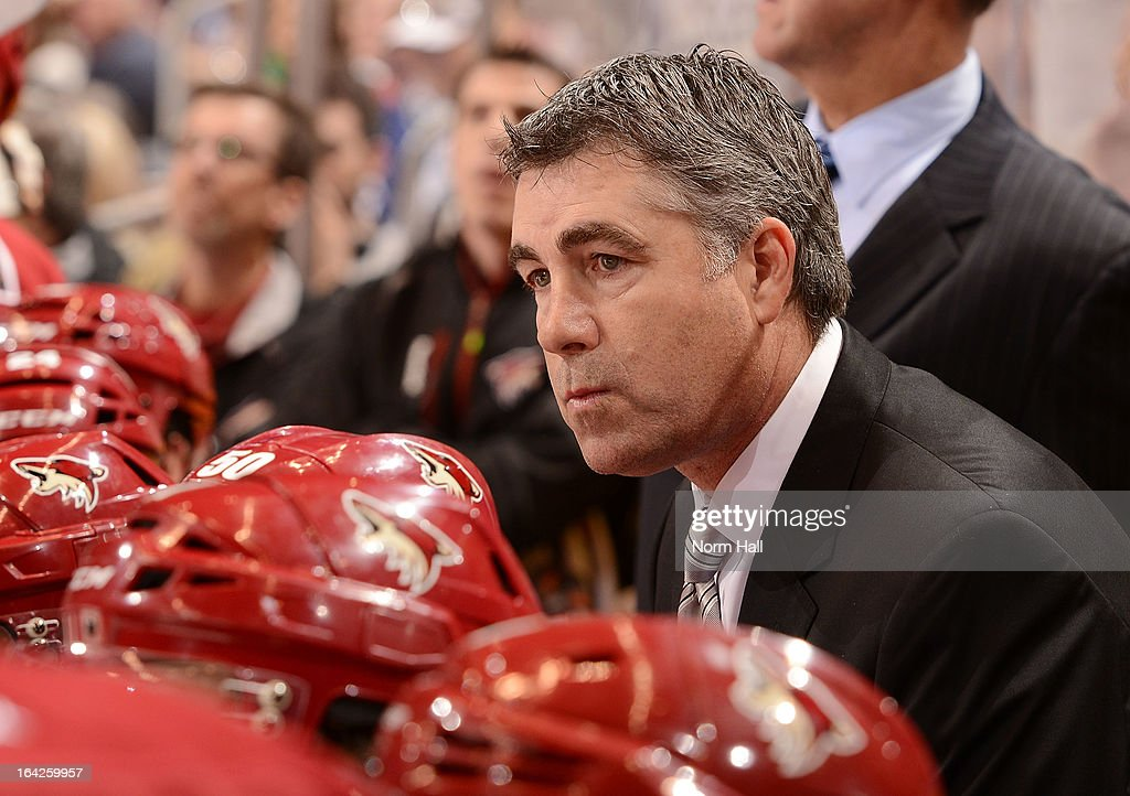 Head coach <a gi-track='captionPersonalityLinkClicked' href=/galleries/search?phrase=Dave+Tippett&family=editorial&specificpeople=700796 ng-click='$event.stopPropagation()'>Dave Tippett</a> of the Phoenix Coyotes looks on from the bench against the Vancouver Canucks at Jobing.com Arena on March 21, 2013 in Glendale, Arizona.