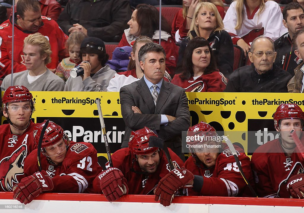 Head coach Dave Tippett of the Phoenix Coyotes reacts on the bench with teammates Martin Hanzal Nick Johnson Kyle Chipchura Alex Bolduc and Oliver...