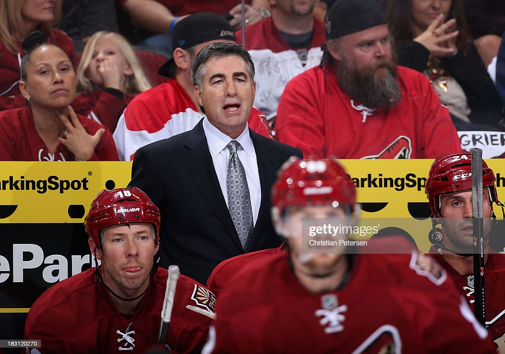 Head coach Dave Tippett of the Phoenix Coyotes reacts on the bench during the home opening NHL game against the New York Rangers at Jobingcom Arena...