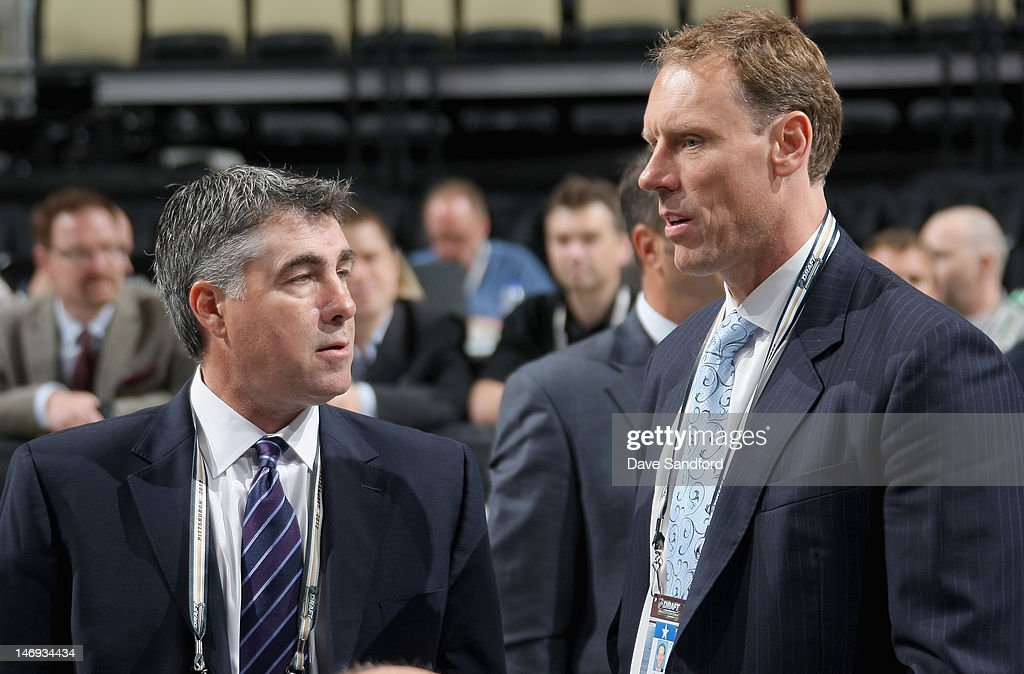 Head coach <a gi-track='captionPersonalityLinkClicked' href=/galleries/search?phrase=Dave+Tippett&family=editorial&specificpeople=700796 ng-click='$event.stopPropagation()'>Dave Tippett</a> of the Phoenix Coyotes stands with goaltending coach <a gi-track='captionPersonalityLinkClicked' href=/galleries/search?phrase=Sean+Burke&family=editorial&specificpeople=204179 ng-click='$event.stopPropagation()'>Sean Burke</a> during day two of the 2012 NHL Entry Draft at Consol Energy Center on June 23, 2012 in Pittsburgh, Pennsylvania.
