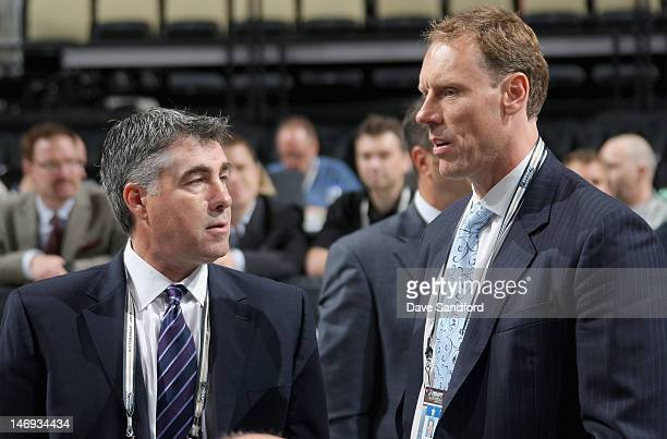 Head coach Dave Tippett of the Phoenix Coyotes stands with goaltending coach Sean Burke during day two of the 2012 NHL Entry Draft at Consol Energy...