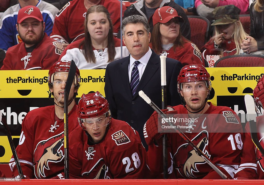 Head coach Dave Tippett of the Phoenix Coyotes watches from the bench during the NHL game against the Chicago Blackhawks at Jobing.com Arena on January 20, 2013 in Glendale, Arizona. The Blackhawks defeated the Coyotes 6-4.