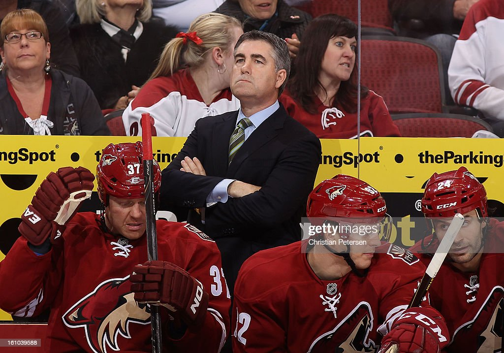 Head coach Dave Tippett of the Phoenix Coyotes watches from the bench during the NHL game against the Chicago Blackhawks at Jobing.com Arena on February 7, 2013 in Glendale, Arizona. The Blackhawks defeated the Coyotes 6-2.