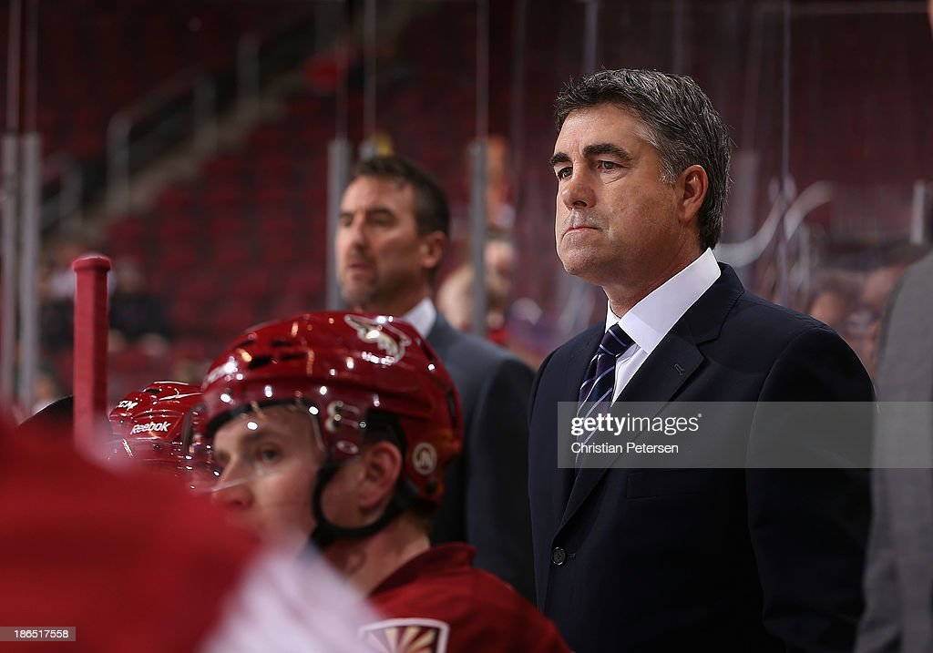 Head coach Dave Tippett of the Phoenix Coyotes watches from the bench during the NHL game against the Nashville Predators at Jobingcom Arena on...
