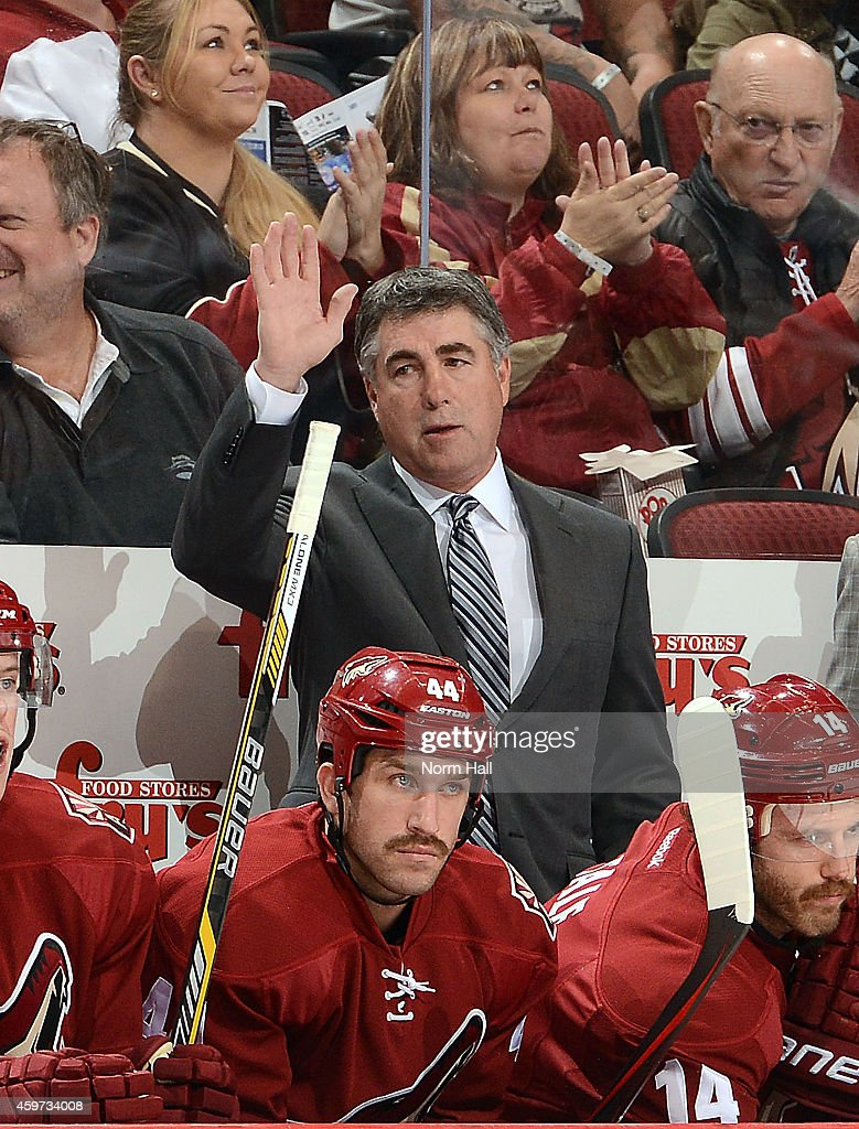 Head coach Dave Tippett waves to the crowd as he recognized for coaching his 400th game with the Arizona Coyotes against the Calgary Flames at Gila...