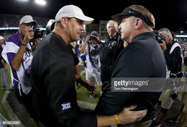Head coach David Beaty of the Kansas Jayhawks talks with head coach Gary Patterson of the TCU Horned Frogs at midfield after TCU beat Kansas 430 at...
