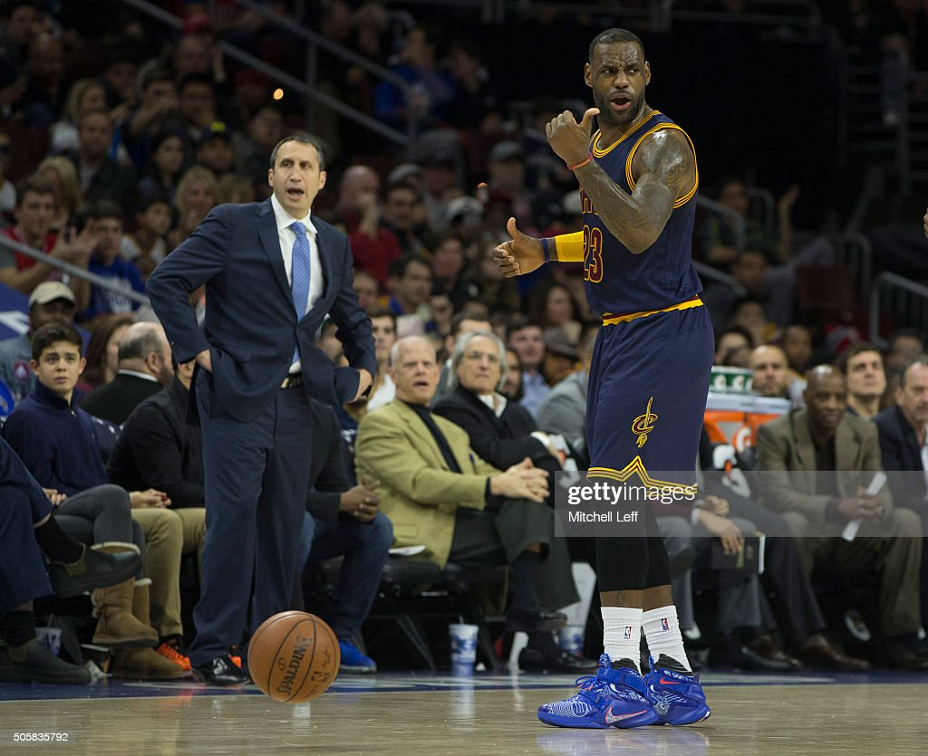 Head coach <a gi-track='captionPersonalityLinkClicked' href=/galleries/search?phrase=David+Blatt&family=editorial&specificpeople=836616 ng-click='$event.stopPropagation()'>David Blatt</a> and <a gi-track='captionPersonalityLinkClicked' href=/galleries/search?phrase=LeBron+James&family=editorial&specificpeople=201474 ng-click='$event.stopPropagation()'>LeBron James</a> #23 of the Cleveland Cavaliers react in the game against the Philadelphia 76ers on January 10, 2016 at the Wells Fargo Center in Philadelphia, Pennsylvania.