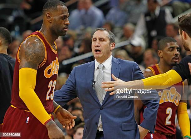 Head coach David Blatt of the Cleveland Cavaliers greets LeBron James of the Cleveland Cavaliers at ATT Center on January 14 2016 in San Antonio...