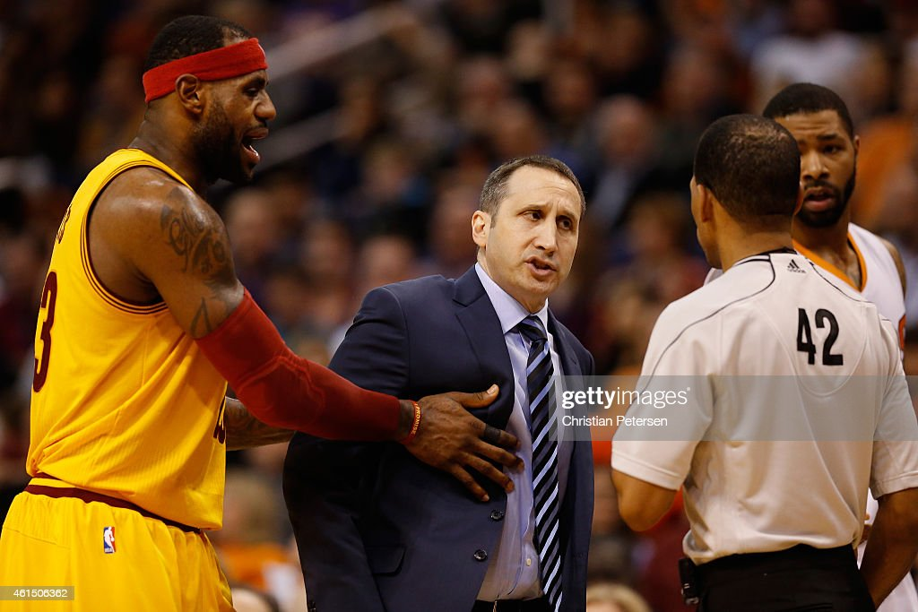 Head coach <a gi-track='captionPersonalityLinkClicked' href=/galleries/search?phrase=David+Blatt&family=editorial&specificpeople=836616 ng-click='$event.stopPropagation()'>David Blatt</a> of the Cleveland Cavaliers reacts to referee <a gi-track='captionPersonalityLinkClicked' href=/galleries/search?phrase=Eric+Lewis+-+Basketball+Referee&family=editorial&specificpeople=4684017 ng-click='$event.stopPropagation()'>Eric Lewis</a> #42 as <a gi-track='captionPersonalityLinkClicked' href=/galleries/search?phrase=LeBron+James&family=editorial&specificpeople=201474 ng-click='$event.stopPropagation()'>LeBron James</a> #23 holds him back during the second half of the NBA game against the Phoenix Suns at US Airways Center on January 13, 2015 in Phoenix, Arizona. The Suns defeated the Cavaliers 107-100.