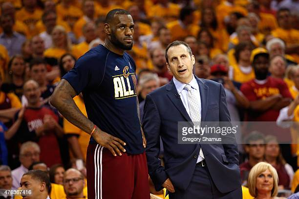 Head coach David Blatt of the Cleveland Cavaliers speaks to LeBron James late in the fourth quarter against the Atlanta Hawks during Game Four of the...