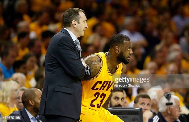 Head coach David Blatt of the Cleveland Cavaliers talks to LeBron James in the first quarter against the Atlanta Hawks during Game Three of the...