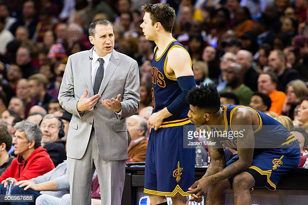 Head coach David Blatt of the Cleveland Cavaliers talks to Matthew Dellavedova and Iman Shumpert during the first half against the Golden State...