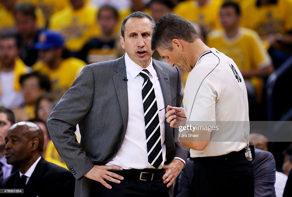 Head Coach David Blatt of the Cleveland Cavaliers talks to referee Scott Foster in the first quarter against the Golden State Warriors during Game...