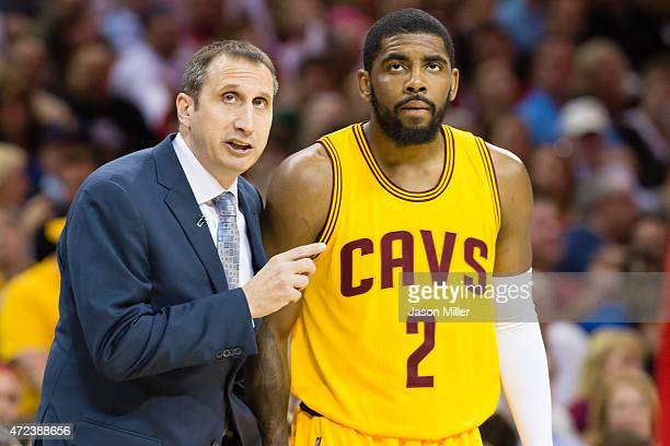 Head coach David Blatt of the Cleveland Cavaliers talks with Kyrie Irving in the first half against the Chicago Bulls during Game Two in the Eastern...