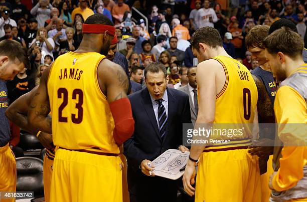 Head coach David Blatt of the Cleveland Cavaliers talks with LeBron James and Kevin Love during the NBA game against the Phoenix Suns at US Airways...