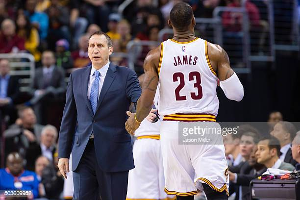 Head coach David Blatt talks to LeBron James of the Cleveland Cavaliers as James leaves the game during the first half against the Toronto Raptors at...