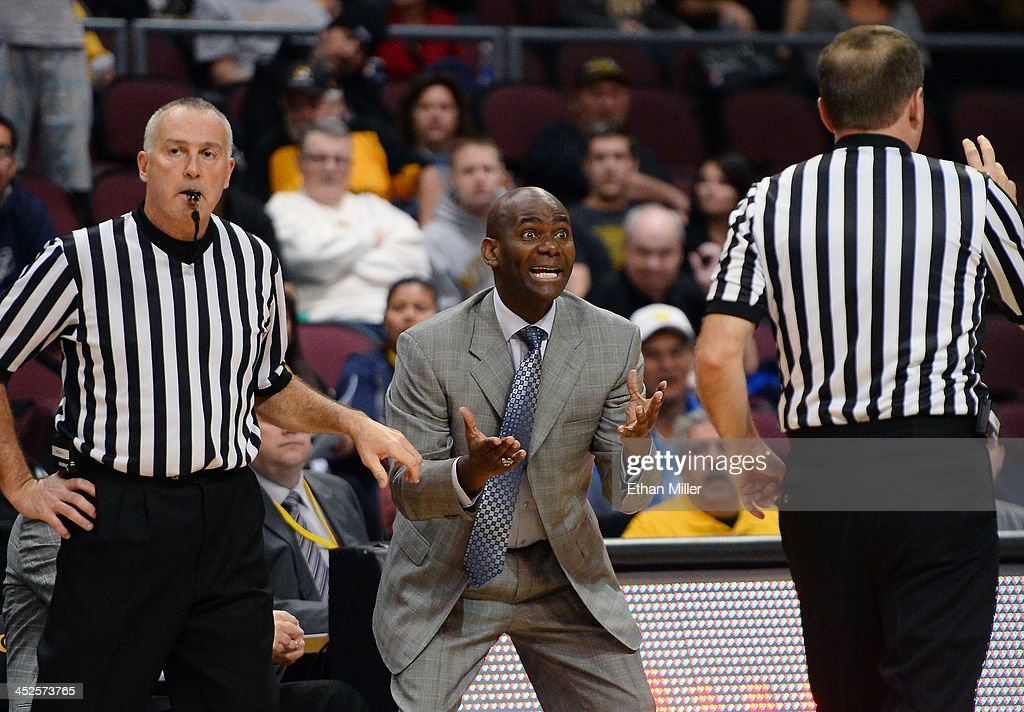 Head coach David Carter of the Nevada Wolf Pack pleads to an official during the team's game against the Missouri Tigers during the Continental Tire Las Vegas Invitational at the Orleans Arena on November 29, 2013 in Las Vegas, Nevada. Missouri won 83-70.