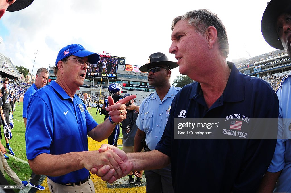 Head Coach <a gi-track='captionPersonalityLinkClicked' href=/galleries/search?phrase=David+Cutcliffe&family=editorial&specificpeople=3265998 ng-click='$event.stopPropagation()'>David Cutcliffe</a> (L) of the Duke Blue Devils is congratulated by Head Coach <a gi-track='captionPersonalityLinkClicked' href=/galleries/search?phrase=Paul+Johnson+-+American+Football+Coach&family=editorial&specificpeople=13721626 ng-click='$event.stopPropagation()'>Paul Johnson</a> of the Georgia Tech Yellow Jackets after the game at Bobby Dodd Stadium on October 11, 2014 in Atlanta, Georgia.