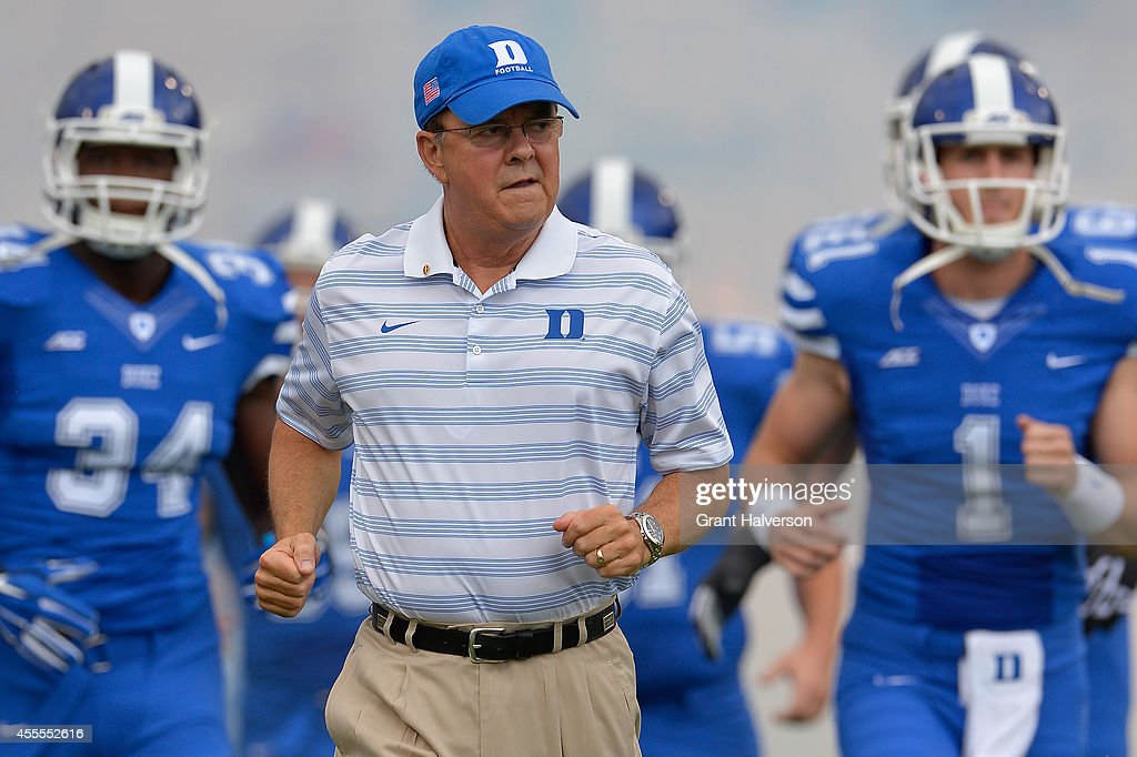 Head coach <a gi-track='captionPersonalityLinkClicked' href=/galleries/search?phrase=David+Cutcliffe&family=editorial&specificpeople=3265998 ng-click='$event.stopPropagation()'>David Cutcliffe</a> of the Duke Blue Devils leads his team onto the field during their game against the Kansas Jayhawks at Wallace Wade Stadium on September 13, 2014 in Durham, North Carolina.