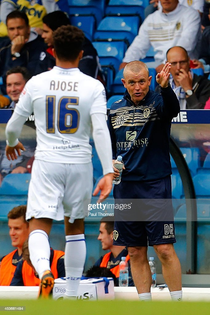 Head coach David Hockaday of Leeds speaks to his player Nicky Ajose during the Sky Bet Championship match between Leeds United and Middlesbrough at Elland Road on August 16, 2014 in Leeds, England.