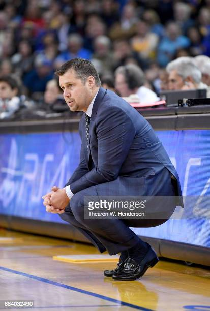 Head coach David Joerger of the Sacramento Kings looks on against the Golden State Warriors during an NBA basketball game at ORACLE Arena on March 24...