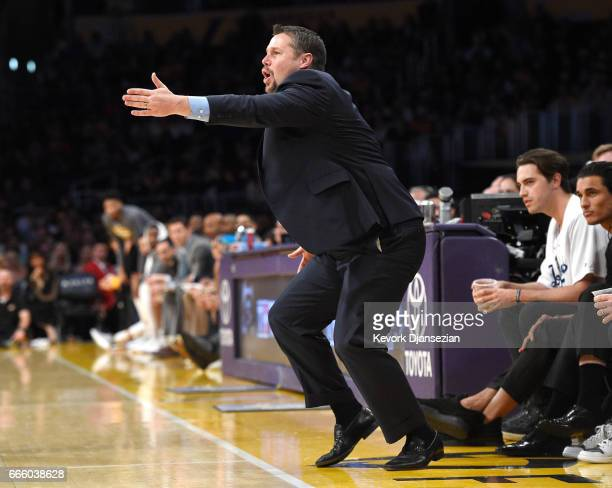 Head coach David Joerger of the Sacramento Kings reacts from the bench during the second half of the basketball game against Los Angeles Lakers at...