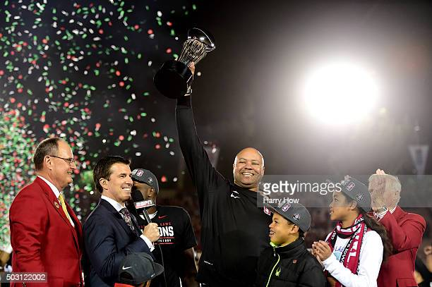 Head coach David Shaw of the Stanford Cardinal holds up the Rose Bowl trophy after defeating the Iowa Hawkeyes 4516 in the 102nd Rose Bowl Game on...