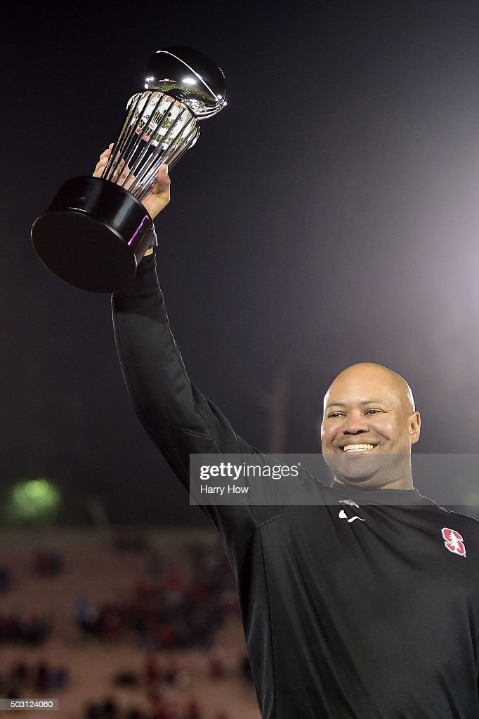 Head coach <a gi-track='captionPersonalityLinkClicked' href=/galleries/search?phrase=David+Shaw+-+American+Football+Coach&family=editorial&specificpeople=8769878 ng-click='$event.stopPropagation()'>David Shaw</a> of the Stanford Cardinal holds up the Rose Bowl trophy after defeating the Iowa Hawkeyes 45-16 in the 102nd Rose Bowl Game on January 1, 2016 at the Rose Bowl in Pasadena, California.