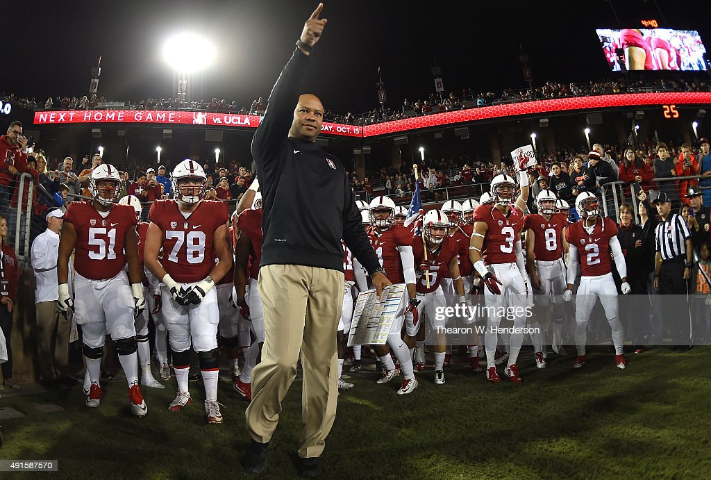 Head coach David Shaw of the Stanford Cardinal leads his team onto the field prior to playing the Arizona Wildcats in a NCAA football game at...